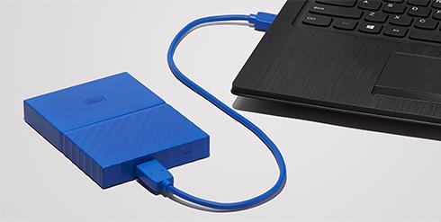 WD Passport Hard Drive plugged into laptop